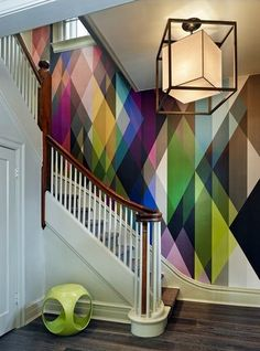 a kaleidoscope of colors in this graphic entryway wallpaper