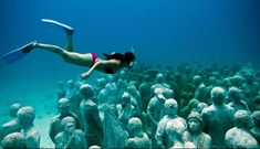 Cancun, Mexico.  Artist Jason DeCaires Taylor's work has pretty much blown out of the water (pun intended) anything that I've seen on land. The sculpter and scuba diver has been causing quite a stir in the media with his newest, largest and most chilling installation yet; 403 life-size human sculptures, spanning 420 square meters of barren sea bed.