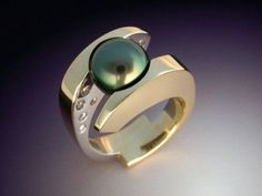Tahitian Black Pearl and Diamond ring in 18k gold and platinum by MetamorphosisJewelry on http://etsy.com