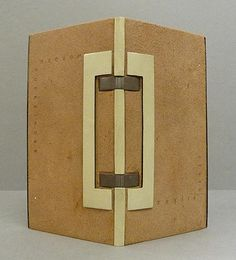 Annie van Bruggen-Menissen. Boekbinder Worden. Wildert, 2004. Jean de Gonet leather binding with vellum spine and exposed sewing on leather straps. Vellum decoration and blind tooling on the boards.