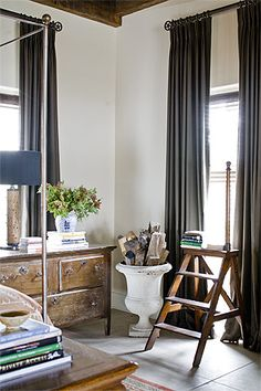 Light walls dark curtains and wood. Great example of how hanging drapes high on a wall makes a huge difference in the look