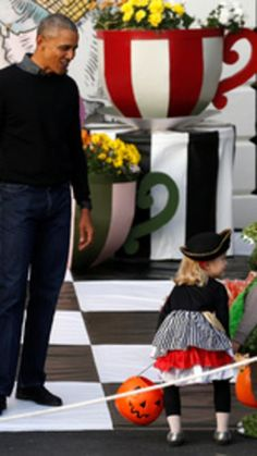 U.S. President Barack Obama gives out Halloween treats to children from the South Portico of the White House in Washington, U.S. October 31, 2016.(REUTERS/Jonathan Ernst) via @AOL_Lifestyle Read more: http://www.aol.com/article/news/2016/11/01/president-obama-greets-trick-or-treaters-lame-duck-white-house/21596225/?a_dgi=aolshare_pinterest#fullscreen