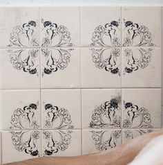 tiles hand printed with design of boys in circle. nice idea for couple of boys moving in together and designing their bathroom... :)