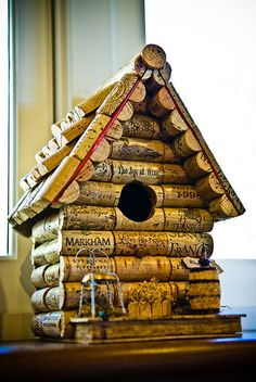 Cork birdhouse (photo idea only.. but use wooden shingles round thin slices of cork for shingles instead?)