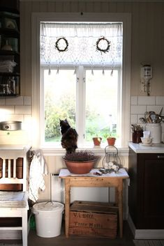 Love the window covering and simple styling of this kitchen look deeper for clues on how to achieve this look.