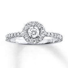 This engagement ring for her features a round diamond haloed by more round diamonds for a sparkling centerpiece that's unforgettable. More diamonds shimmer along the 14K white gold band, bringing the total diamond weight to 5/8 carat. Diamond Total Carat Weight may range from .58 - .68 carats.