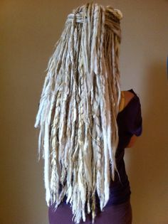 Everyone laughs at me when I say I would totally get dreads if I could pull them off. These are awesome. End of story.