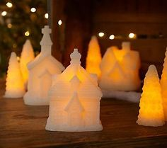 A glittery holiday village? Yes, please! {Flameless Glitter Village with Timer by Valerie}