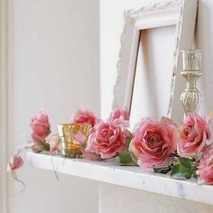 so many of my loves..a mantle....roses...mercury glass and an empty frame....