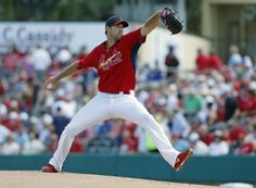 starting pitcher Michael Wacha throws the ball against the New York Mets in the first inning during a spring training game. Cards won the game 7-1.  3-02-14