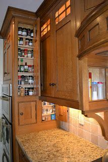 Concealed spice and oil storage in Craftsman style cabinets by Joe Davenport.