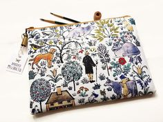 wash bag women,farm animal,farmhouse,makeup bag,makeup brush holder,art bag,book bag,tablet sleeve,animal print,rats,farm life,travel bag. It measures... 28cm x 20cm It has one interior pocket measuring 23cm x 15cm Is also lined in a coordinating fabric. My products are made from a
