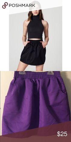American Apparel Tulip Skirt In PURPLE American Apparel Tulip Skirt In PURPLE , purchased and never wore :( it runs a size smaller so i would suggest it for anyone thats an XS ! American Apparel Skirts Mini