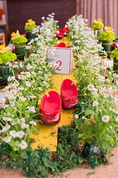 Wizard of Oz Party Inspiration Ruby slippers. Photography by emmaandjosh.com. Design by cobaltevents.com. Paper goods by thepaperdoor.net. Florals by tictock.com.