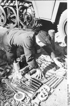 Mechanic laying out tools to work on an Sd.Kfz. 250, southern France on the Spanish border, 1942