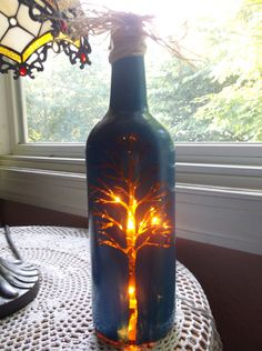 Hey, I found this really awesome Etsy listing at https://www.etsy.com/listing/197245600/bare-tree-wine-bottle-lamp