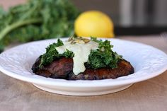 Portobello mushrooms with lemon kale and a creamy pumpkin seed sauce!  Mmmmm.  Vegan and Legume free!