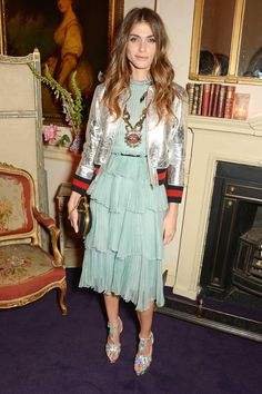 Elisa Sednaoui in a silver Gucci bomber jacket and frothy mint tiered party dress