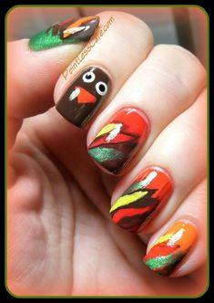 Turkey Feathers /  23 Snazzy Nail Ideas For Thanksgiving (via BuzzFeed)