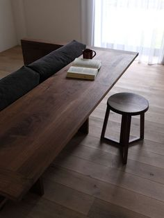 "CARAMELLA Counter Sofa - really fantastic idea or it could be a ""console"" table...not sure about the wood armrest though"