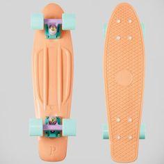 Penny board in peach w/ mint blue wheels.