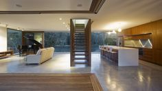 example of interior concrete floor with timber veneer joinery and hardwood exterior decking: Narrabeen House by Choi Ropiha Fighera | HomeDSGN