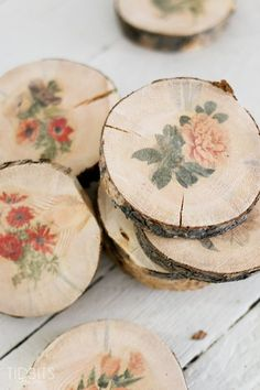Transferring botanical prints onto these cute wood slice coasters will add a…