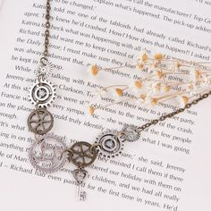 Gear Wheel Necklace - This necklace is made from small gear wheels, iconic for Steampunk.The finely forged zinc alloy gives the pendant a silver look and makes the many small details possible.