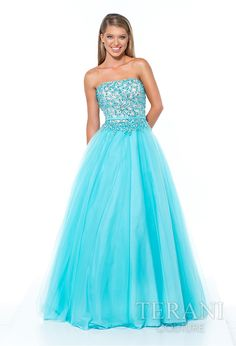 Strapless tulle ball gown with delicate sequin embellishments covering the bodice and continuing to the high hip, the dress is finished with a satin belt and full tulle skirt