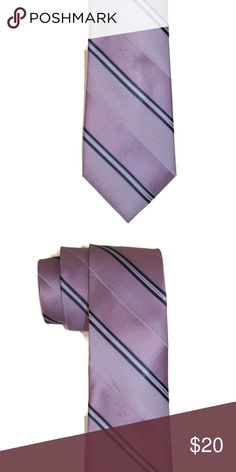 NWT Lilac 100% Silk Neck Tie DKNY Men's Designer 100% Silk Classic Saffron Stripe Purple Necktie.   100% Silk necktie. The coloring is lilac and then a very nice navy blue and silver thread between the navy blue stripes  56 in long, 3 in wide at arrow, one size fits most Great for office dress or business casual Dkny Accessories Ties