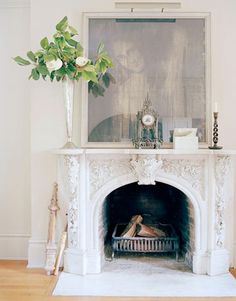 The carved Italian marble fireplace - House Beautiful, Feb 2010 issue. Eventually want to redo fireplace in living room so it is more French or Italian Small Fireplace, Concrete Fireplace, White Fireplace, Farmhouse Fireplace, Marble Fireplaces, Fireplace Mantle, Fireplace Surrounds, Fireplace Design, Fireplace Ideas