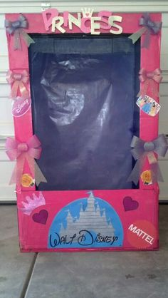 "Three 3' x 5' pieces if card board... i used 60"" tv boxes... three cans of spray paint... bows from dollar tree, etc... and now you have a cute photo booth for girly Disney Princess party.... my version on a doll box ;)"