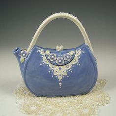 Blue lace teapot purse.