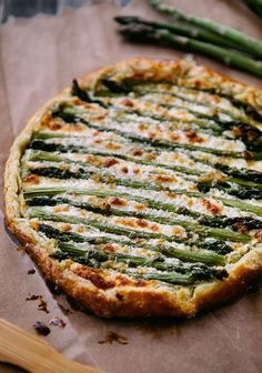 Asparagus Goat Cheese Galette. Gorgeous. Im in an asparagus state of mind. should work with sprouted whole grain too. but keep the crust thin.