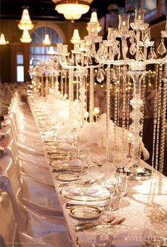tall candelabras and pearls- cost efficient + grand centerpieces. doesn't kill hella flowers