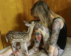 Tattooed girl with a fawn