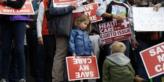 CONGRESS THREATENS TO TAKE HEALTH INSURANCE AWAY FROM 9 MILLION KIDS, JUST BECAUSE    Supporters of the Affordable Care Act who are also opponents of Colorado's GOP-led plan to undo Colorado's state-run insurance exchange gather for a rally on the state Capitol steps in Denver,   . .  .