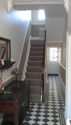 *Forget the idea of stripes and pattern -my hallway is too small* Really like the dado rail continuing up the stairs Dado Rail Hallway, Grey Hallway, Tiled Hallway, Front Hallway, Stair Walls, Carpet Stairs, House Stairs, Edwardian Hallway, Black And White