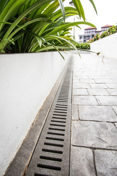 HDB Jonite Trench Grates have been used to enhance the aesthetics of the estates while not compromising on the durability and functionality of materials. Outdoor Walkway, Outdoor Flooring, Outdoor Landscaping, Outdoor Gardens, Landscape Drainage, Yard Drainage, Drainage Solutions, Drainage Ideas, Diy Driveway