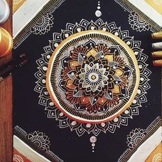 """Believe you can, and you will"" Gold and silver mandala I mostly used a the gold, silver and bronze sharpies and also some gel pens and paint"