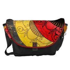 FAN-tastic (Personalized Messenger Bag) - Just as its' name implies, this bag truly is fantastic! From the beautiful original artwork by IconDoIt that is a collage of brightly colored (yellow, red, black & gold), gracefully decorated, silk hand fans  - to the personalized dedication block on the bottom - to the sturdy construction & roominess of the bag itself. #oriental_fans_messenger_bag #personalized_commuter_bag #chic_shoulder_bag