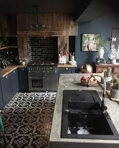 Absolutely love the floor tile and the brick behind the stove.