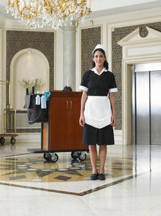 View top-quality stock photos of Maid Standing By Cleaning Trolley In Hotel Foyer Smiling Portrait. Find premium, high-resolution stock photography at Getty Images. Maid Outfit, Maid Dress, Hotel Foyer, Forced Haircut, Cleaning Maid, Mold In Bathroom, Staff Uniforms, Maid Uniform, 50s Dresses