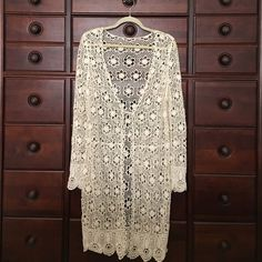 Long Boho Crochet Cardigan Cream M Long Boho Crochet Cardigan in flower pattern. Rich cream color. Front tie closure at empire waist. There is a stitch definition at actual waist. Please see full length photo. Minor detail but very flattering on! Last photo shows trim detailing which is on the bottom and sleeves of the sweater! My daughter cut out all the tags because of the open weave knit-idk the brand or actual size but will fit S or M. So adorable over flowy dress with boots or jeans and…