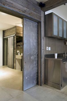 Avoid The Dreaded Swing Door; A Barn Door Separates . Love The Modern Barn Door Idea Barndominium Puertas . These Bypassing Barn Doors Covers A Nook Right In Front Of . Home Design Ideas The Doors, Windows And Doors, Sliding Doors, Barn Doors, Style At Home, Industrial House, Industrial Chic, Kitchen Industrial, Industrial Stairs