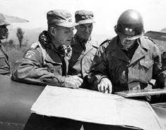 Major General William M. Hoge (right), commander of IX Corps, studies map at Chunchon airstrip, May, 1951, with General Matthew B. Ridgway (left), Far East commander, and Lieutenant General James A. Van Fleet, Eighth Army commander.