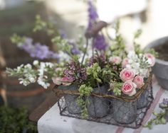 take flowers put in find found wire container and tin can then decorate your table tops