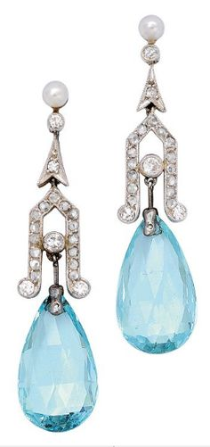 A Pair of Aquamarine and Diamond Ear Pendants, circa 1910 Suspending a pair of aquamarine briolette drops together weighing approximately 10.00 carats, from delicate diamond-set geometric motifs, topped by a pair of small pearls, mounted in platinum and 18k white gold, pearls not tested for natural origin