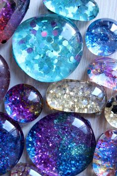 ~What You Will Need~     •Clear Flat Back 'marbles'.  •Strong Magnets. •E6000 Glue. •Glitter or Small Pictures •Paint Brush. •Varnish.(Folkart)