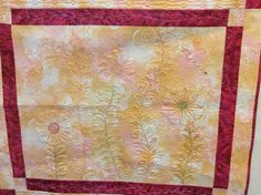 My flower garden quilted in the Craftsy class Beyond Basic Machine Quilting.
